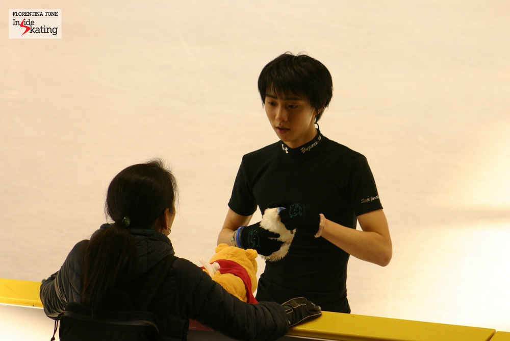 Yuzuru Hanyu, his former coach Nanami Abe and Winnie-the-Pooh at the 2012 Worlds in Nice, during a practice session