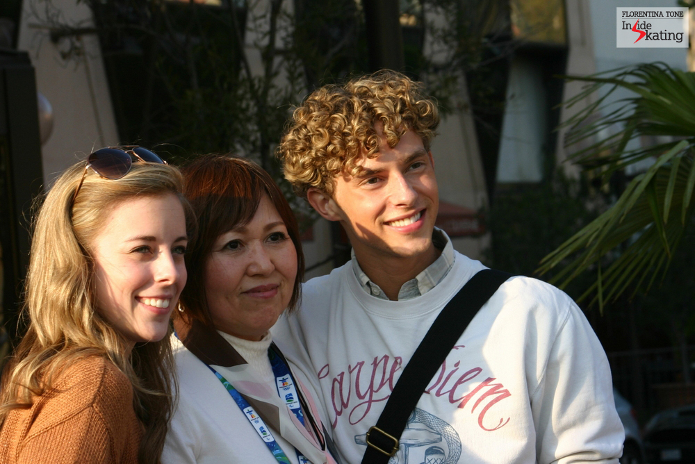 Ashley Wagner and Adam Rippon taking a picture with a fan, in Nice, at the 2012 Worlds