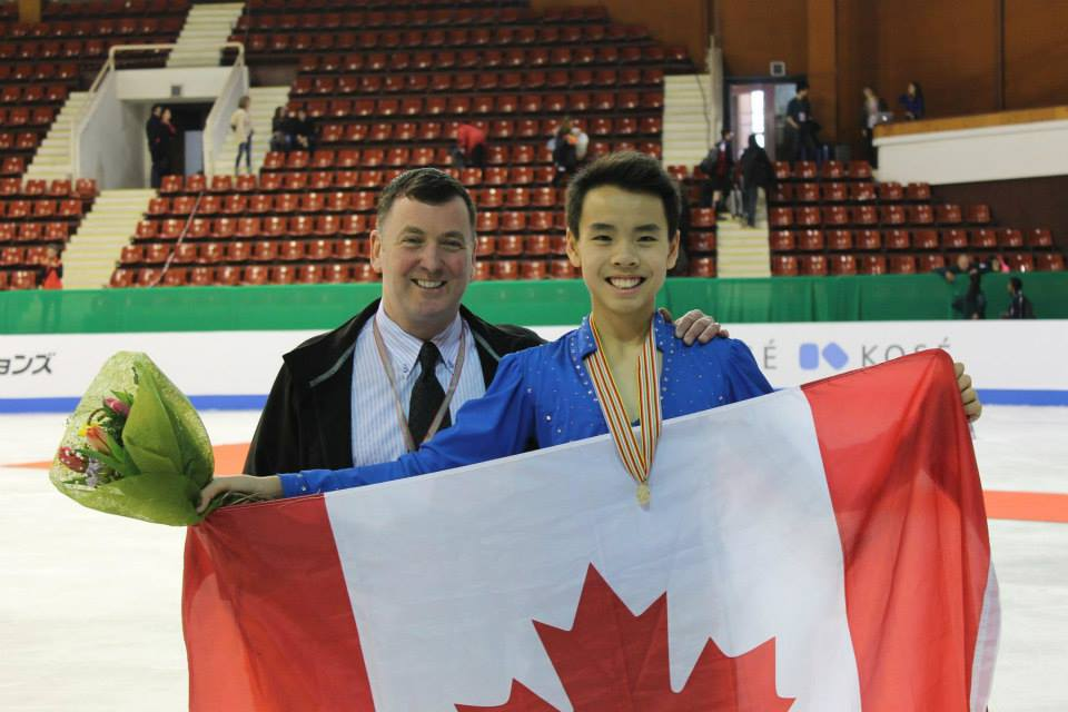 Brian and Nam holding the Canadian flag (Photo: Andriana Andreeva)