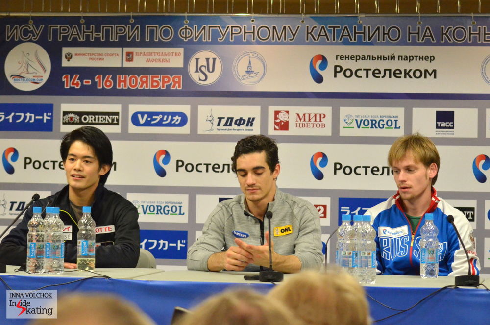 The winners of the short program in the men's event at the press conference in Moscow