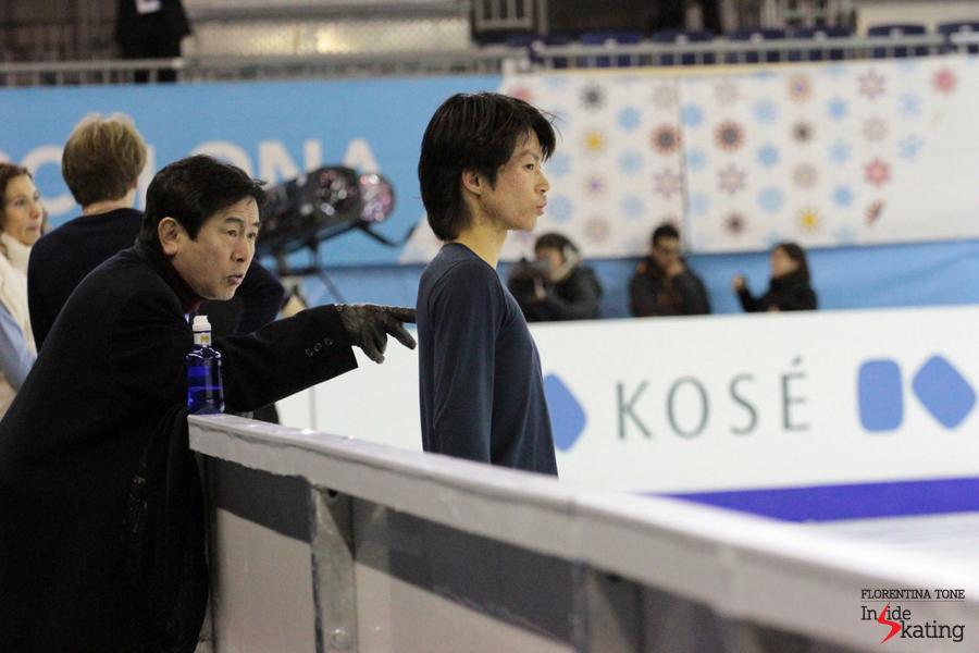 Tatsuki Machida alongside coach Yoshinori Onishi