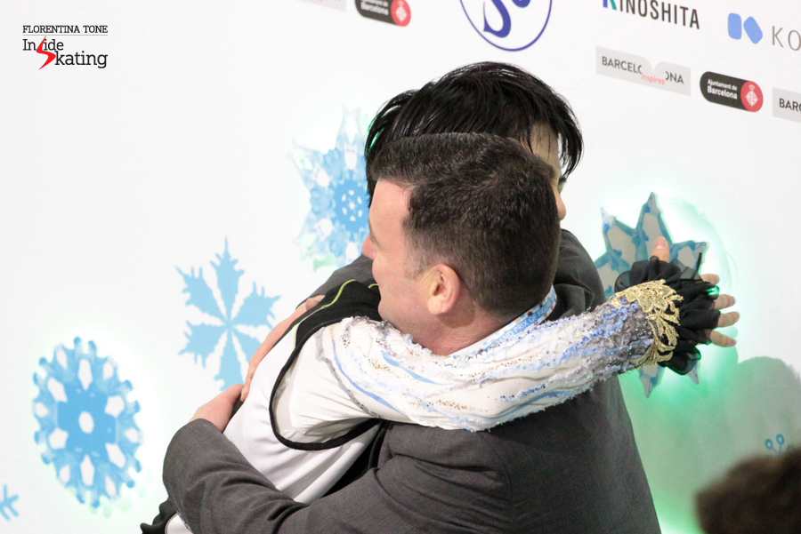 The skater embraces his coach