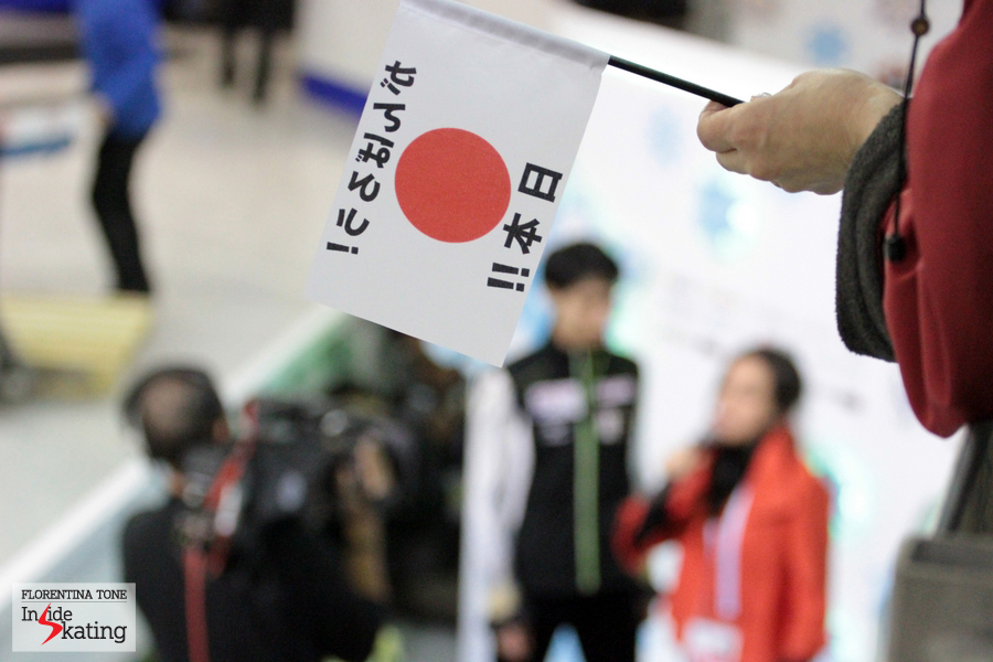 A Japanese flag - and Yuzuru Hanyu, alongside Sara Hurtado, in the background