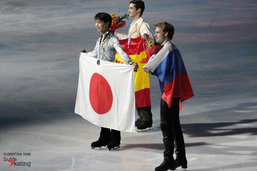 The winners and their flags: Yuzuru Hanyu (Japan), Javier Fernandez (Spain), Sergei Voronov (Russia)