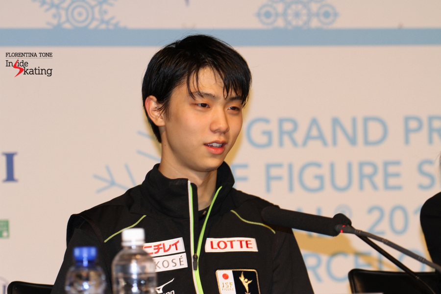 Glimpses of joy: the 2014 Grand Prix Final Champion, Yuzuru Hanyu, during the press conference after the men's free program