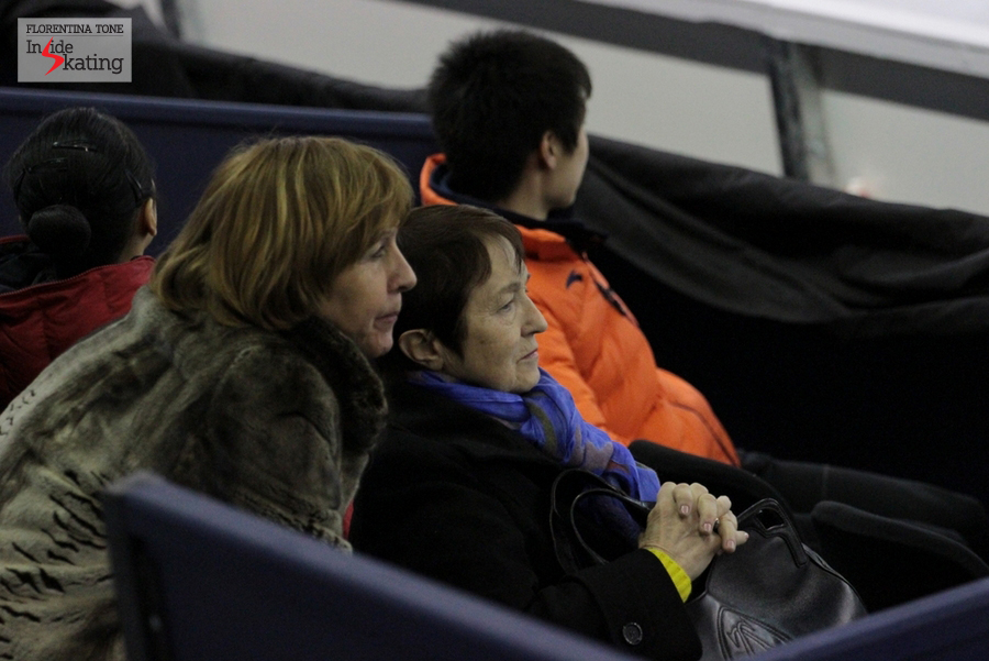 Tamara Moskvina watching the ladies' practice; in the background, the Chinese Boyang Jin, 2013 Junior Grand Prix Final champion, who tries to defend his title in Barcelona
