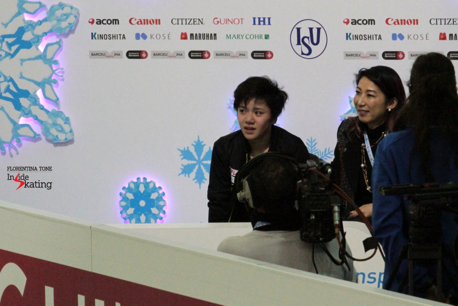 An emotional moment for Shoma Uno and his coach in the Kis and Cry, after the free program; his expression says it all