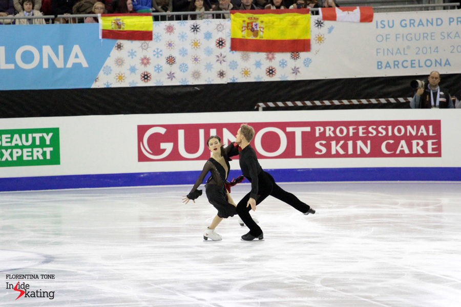 "Madison Chock and Evan Bates skating their short dance to music from ""Don Quixote"" in an arena tapestried with Spanish flags"