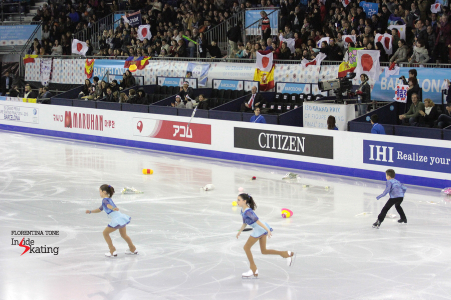Children rushing to the ice, to pick up the toys and the flowers thrown to Yuzuru at the end of his program