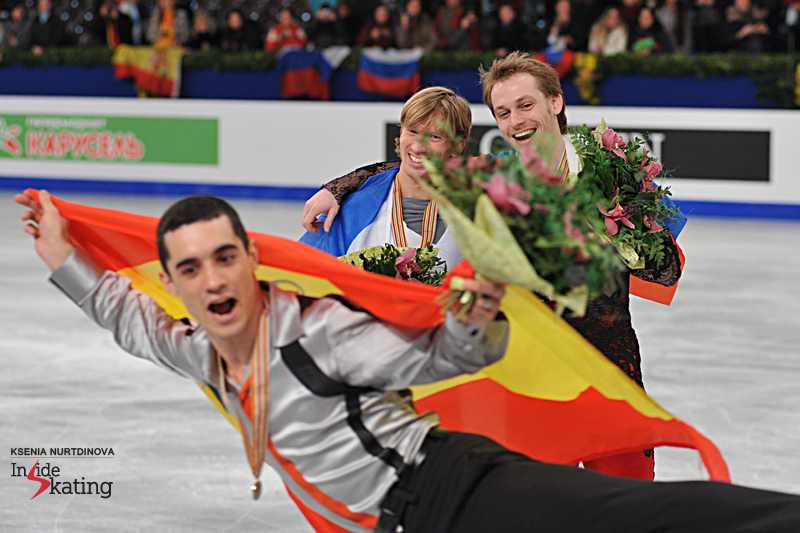 Is it a ballerina, is it Batman...? Javier Fernandez making jokes with Sergei Voronov (silver) and Konstantin Menshov (bronze) during the victory ceremony in Budapest