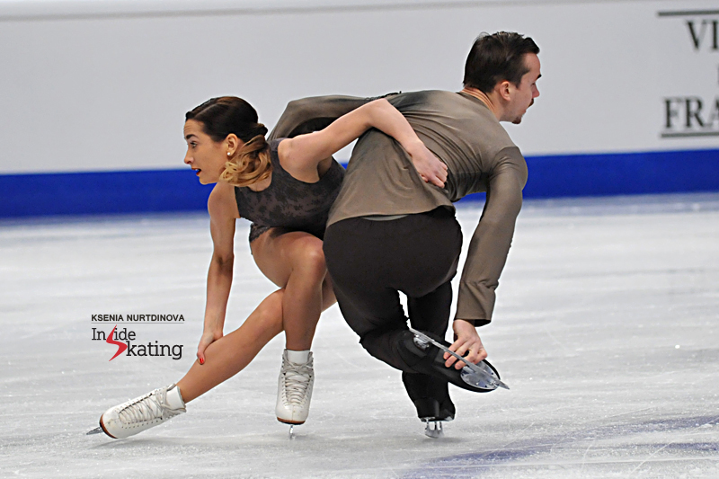"""Ksenia Stolbova and Fedor Klimov's program to """"Notre Dame de Paris"""" featured a triple twist, a triple toe-double toe-double toe combination, as well as difficult lifts and spins, but, after Klimov fell towards the end of the program, they omitted the last element, a throw Salchow. The Olympic silver medalists were ranked second in the free skating and slipped to second place overall."""