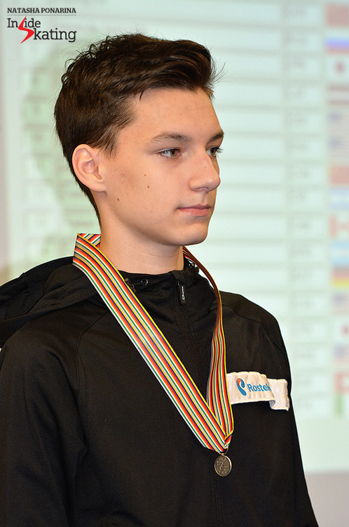 A small silver medal for Adian Pitkeev, at the end of the men's short program in Tallinn