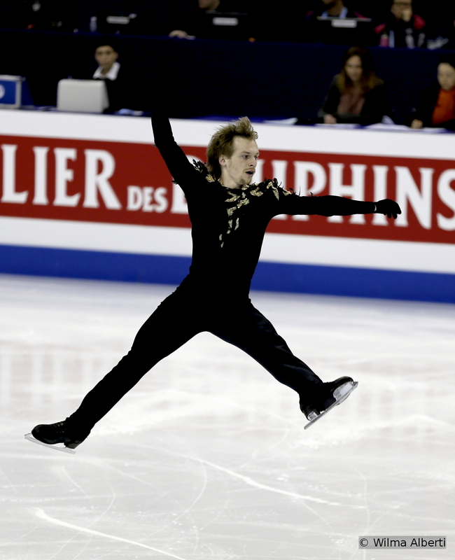 """Three months after the bronze he won at the Grand Prix Final in Barcelona, where he finished behind Yuzuru Hanyu and Javier Fernandez, the 27-year-old Sergei Voronov just couldn't keep up with his younger or less fatigued colleagues; for Voronov, the Worlds have been the 8th competition of the season (he medaled in 6 of them). Sergei started the event in Shanghai with an encouraging 4th place after the short (his SP to """"Danse Macabre"""" – photo above – is technically very challenging), but found himself wobbling during the free; the Russian finished the overall event on the 13th place."""