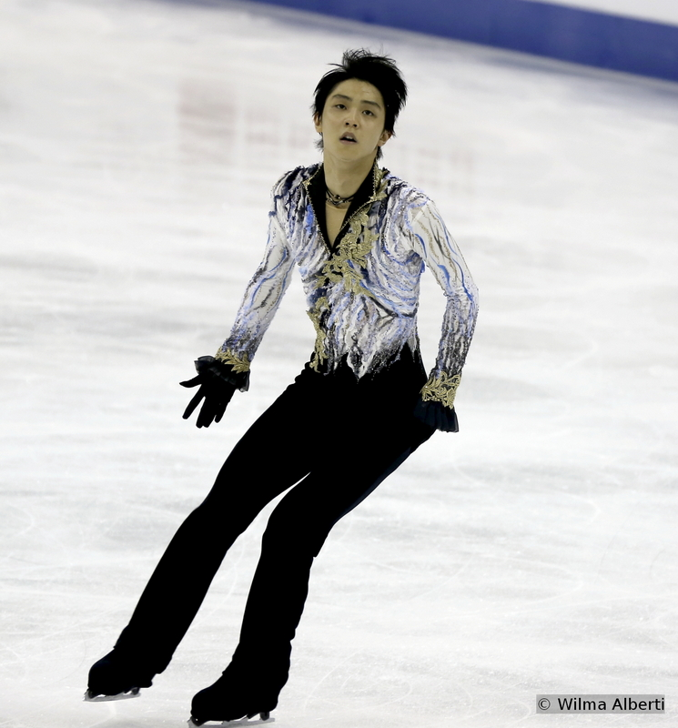 """After the bronze at 2012 Worlds and the gold he won last year in Saitama, the silver medal was the only one missing from Yuzuru Hanyu's trophy case at Worlds – and he got this particular medal in Shanghai. Still, the defeat was hard to take for a fighter and a champion like Yuzuru – but he gracefully accepted it; and he even found resources to be happy for his team mate, Javier Fernandez. The photo above shows Yuzuru performing to """"The Phantom of The Opera"""" in Shanghai Oriental Sports Center."""