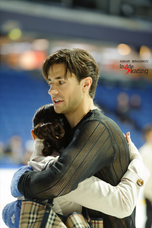 A photo that is worth a thousand words: Andrew Poje, coach Anjelika Krylova and a pair of blue mittens