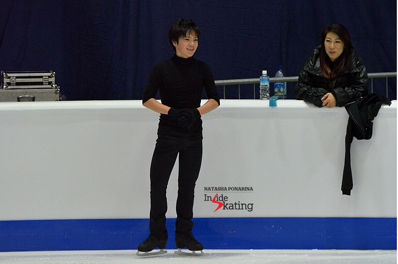 Shoma Uno and coach Mihoko Higuchi during a practice session at 2015 Worlds in Tallinn