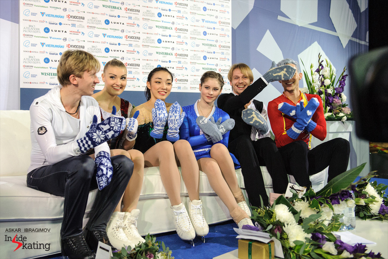 Fun and laughter, mittens and colors, in the Kiss and Cry, with the medalists in the ladies and men's event; from left to right: Konstantin Menshov (gold), Joshi Helgesson (bronze), Rika Hongo (gold), Julia Lipnitskaia (silver), Sergei Voronov (bronze), Adam Rippon (silver)