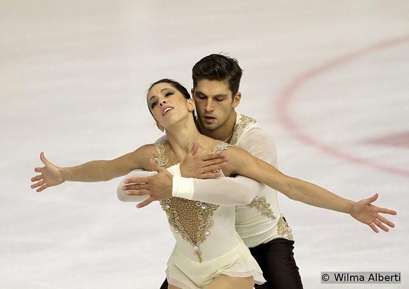 "At the end of the Short Program segment of the competition, Italy's Nicolle Della Monica and Matteo Guarise were laying in second, after performing a moving routine, to ""Magnificat"" by Mina"