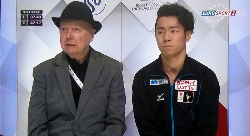 Daisuke Murakami alongside coach Frank Carroll, in the Kiss and Cry, at this year's edition of Skate Canada (photo: Eurosport Screenshot)