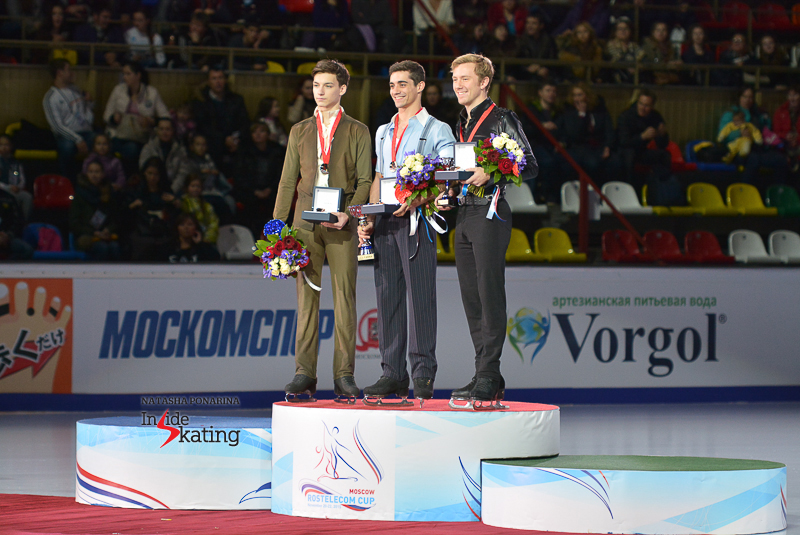 The podium in the men's event at 2015 Rostelecom Cup; from left to right: Adian Pitkeev (silver), Javier Fernández (gold), Ross Miner (bronze)