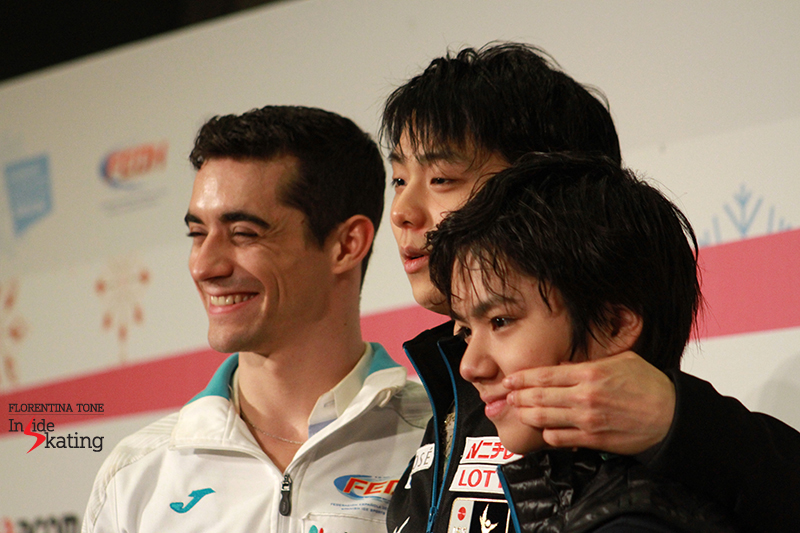 The (now) famous snapshot in which Yuzuru pinches Shoma's cheek, in order to make him smile