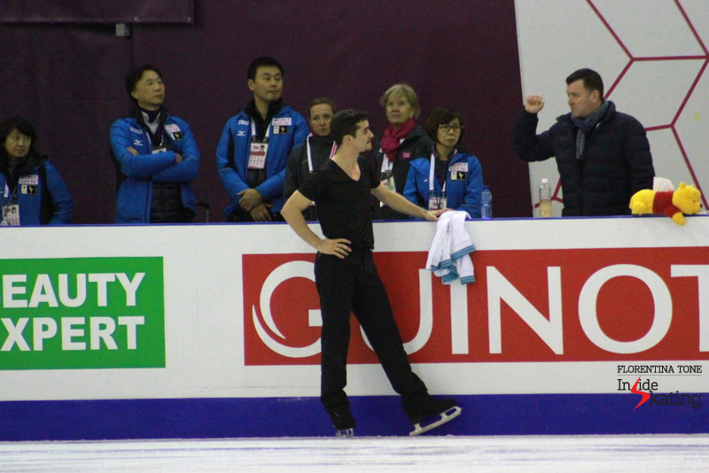 Javier Fernandez at the boards, talking to Brian Orser