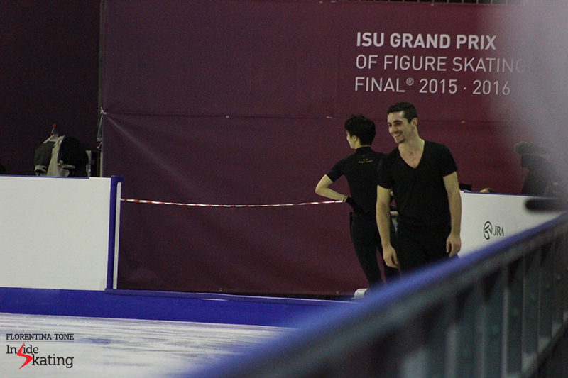 Yuzuru Hanyu and Javier Fernandez, exchanging looks and smiles after Boyang Jin's perfect quad Lutz during practice at 2015 GPF