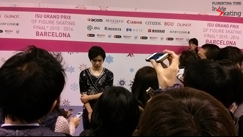 An army of ears, phones, recorders, notebooks surround Shoma Uno, at the end of his short program in Barcelona