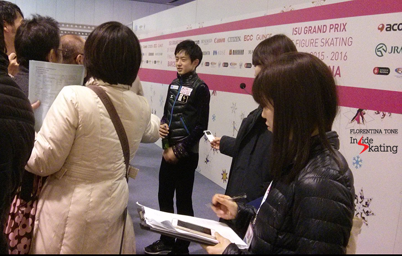 Japan's Stota Yamamoto surrounded by journalists in the Mixed zone