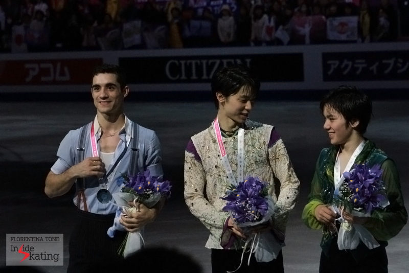 Posing for the photographers at the end of a glorious night for figure skating