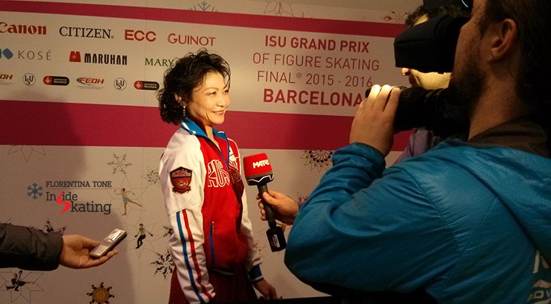 A happy Yuko Kavaguti talking to the journalists in the Mixed zone, after the pairs' short program