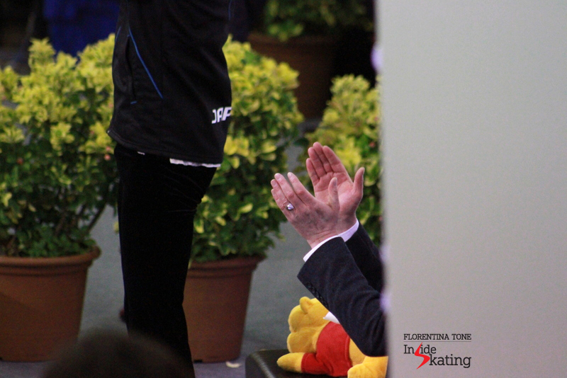 Brian Orser's palms, applauding Yuzuru while waiting for the scores...