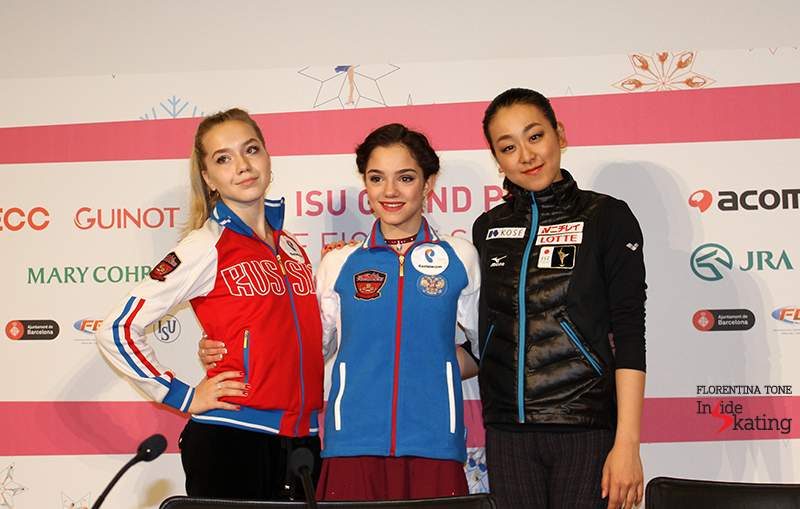 Elena Radionova, Evgenia Medvedeva and Mao Asada posing for the photographers during the press conference after the short program