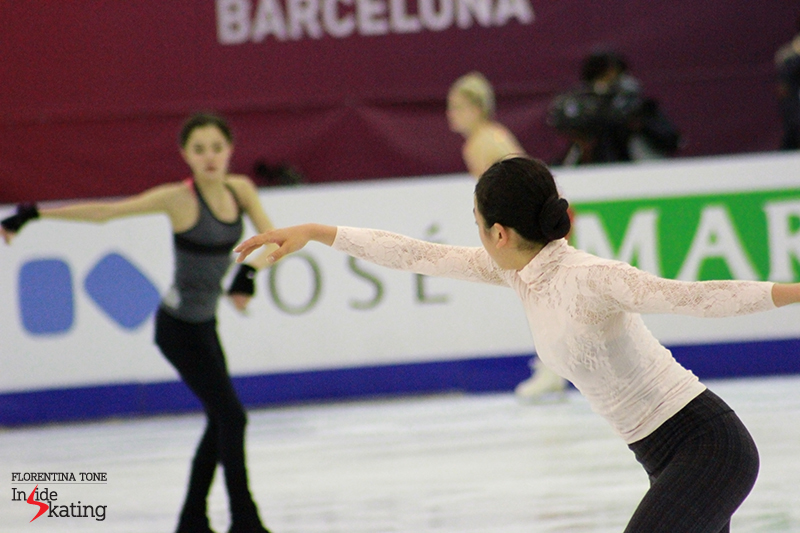 Arms in the air: Mao Asada (in the foreground) and Evgenia Medvedeva