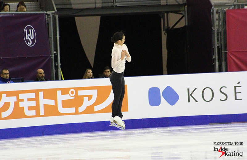 In the air, during her trademark jump: the triple Axel