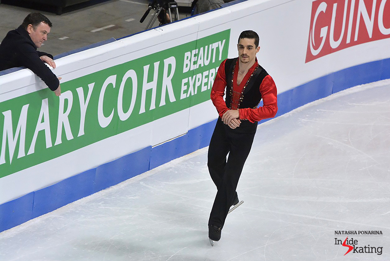 Javier Fernández takes the ice for his short program, while Brian Orser hits the boards in encouragement
