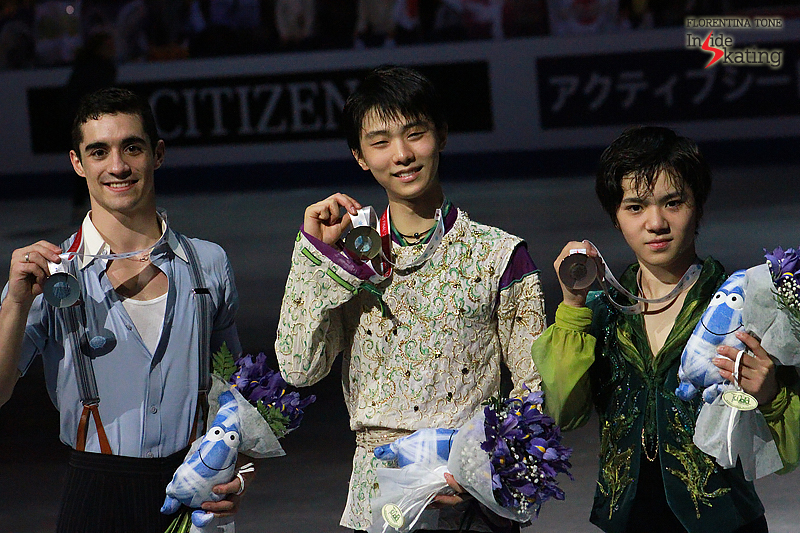 The three medalists in the men's event posing for the photographers