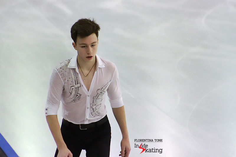"A focused  Dmitri Aliev during the 6-minute warm-up prior to the short program' segment of the competition; this season, Dmitri skated to ""Nothing the Same"" by Gary Moore"