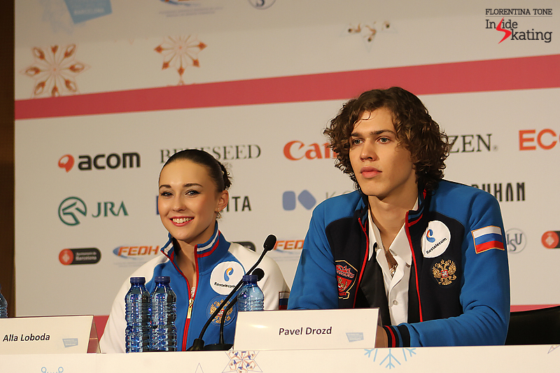 A smiling Alla and a serious Pavel during the press conference after the free dance in Barcelona, at the 2015 Junior Grand Prix Final