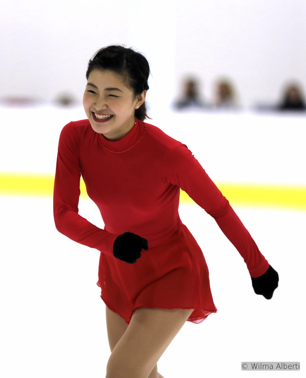Two faces of Kanako Murakami, 6th place in Bergamo: joyously laughing, in her red costume, seconds before entering the role of Carmen in her short program, and then focused, in-all-seriousness, during her Tosca free skate; both routines have been choreographed by Mihoko Higuchi.