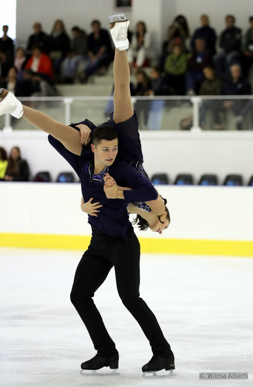 "…while Josh Groban's voice (""You Raise Me Up"") accompanies them in the free skate"