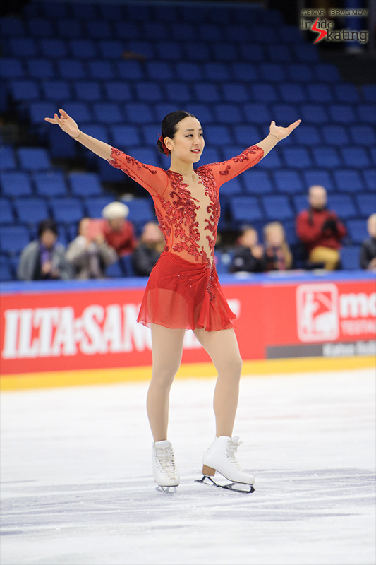 Symphony in red and white and blue: a serene Mao Asada gracefully thanking the audience during the medal ceremony in Espoo