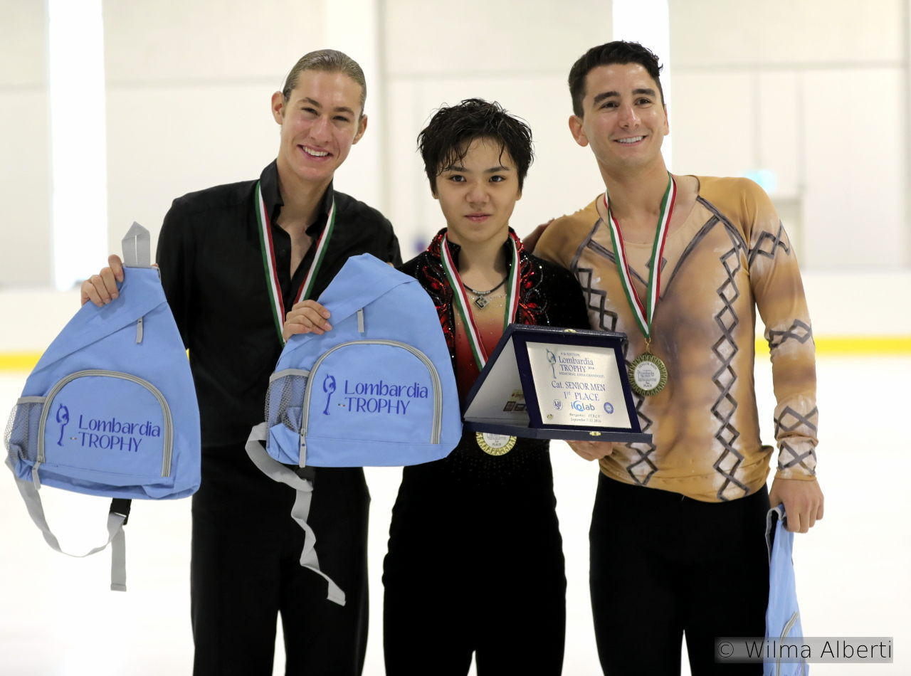 The three medalists in the men's event at 2016 Lombardia Trophy, proudly showing their gifts and medals
