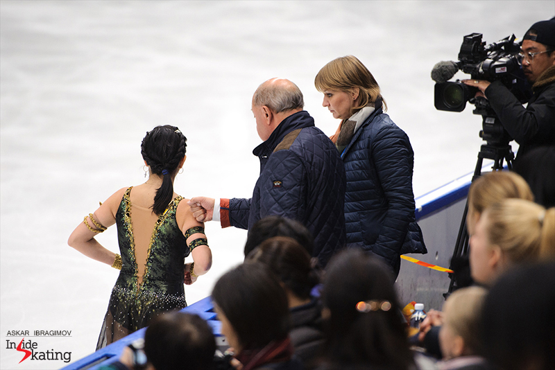 "Alexei Mishin and Tatiana Prokofieva alongside Elizaveta: final words of encouragement before she takes the ice for her ""Cleapatra"" free skate in Espoo, at 2016 Finlandia Trophy"