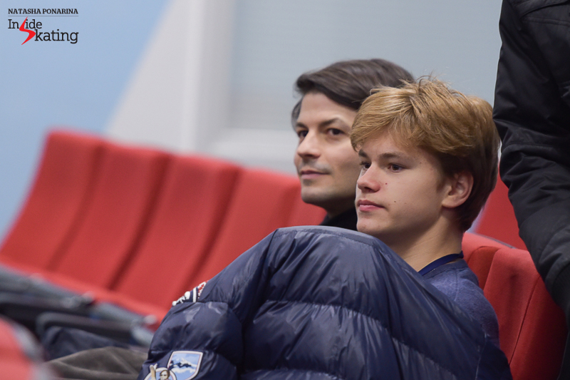 Deniss, alongside coach Stephane Lambiel during the draw