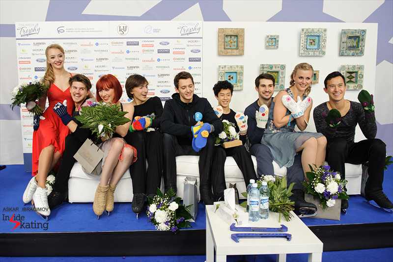 The medalists in the dance and men's events at 2016 Finlandia Trophy – Maxim Kovtun (center) wears the blue-yellow mittens gifted by Emilia