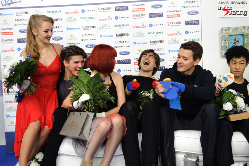 Fun, fun, fun in the Kiss and Cry at 2016 Finlandia Trophy in Espoo. From left to right: Alexandra Stepanova and Ivan Bukin (gold), Tiffany Zahorski and Jonathan Guerreiro (bronze – and Jonathan seems to have the time of his life), Maxim Kovtun (bronze) and Nathan Chen (gold)