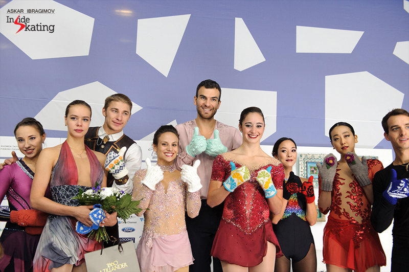 Flower mittens for the medalists in the pairs and ladies' events. From left to right: Kristina Astakhova and Alexei Rogonov (silver), surrounding Anna Pogorilaya (bronze), Meagan Duhamel and Eric Radford (gold), Kaetlyn Osmond (gold), Mari Vartmann and Ruben Blommaert (bronze), with Mao Asada (silver) between them