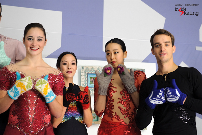 Colorful close-up of Kaetlyn Osmond, Mari Vartmann, Mao Asada, Ruben Blommaert – and their flower mittens