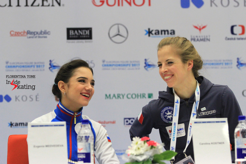 All smiles - Evgenia Medvedeva and Carolina Kostner during the press conference after SP